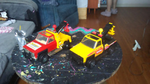 Two old Tonka tow trucks with metal chassis