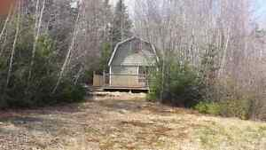 2 storey camp on 1.5 acre lot.