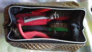 Dog grooming kit and other grooming items.
