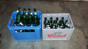35 Grolsch 500mL beer bottles with hard plastic cases