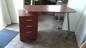 Desk with filing cabinet.
