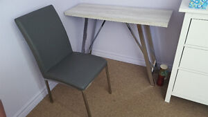 Elegant side table with matching chairs