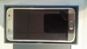 Samsung S7 ***NEW !! NEVER USED ...IN BOX... ROGERS