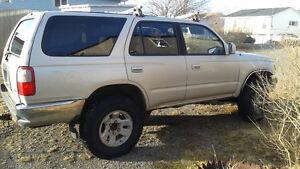 4Runner, needs work, still runs. 4 new tires on rims