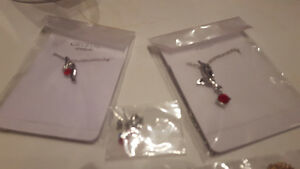 several pieces of brand new costume jewellery