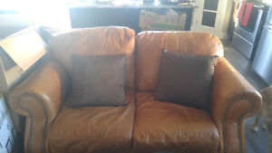 Rust leather loveseat and couch