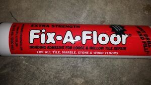 fix a floor loose tile glue - left over from my repairs Windsor Region Ontario image 1