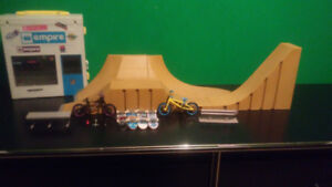Toy Tech Decks, 2 bmx, and ramps with rail and bench