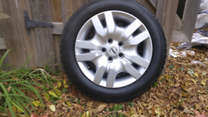 Nissan Snow Tire Set with OEM Wheel Covers