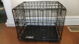 brand new small dog crate , good for dogs up to 12 lbs