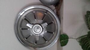 2 original 1964 corvette hubcaps