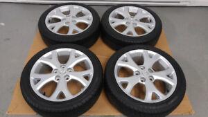 4 pneus d'été 205/50/R17 PIRELLI P6 sur mags d'origine MAZDA