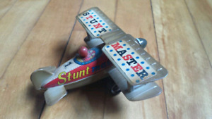 AIRPLANE stunt master toy and SCHYLLING penny toy  $10 each