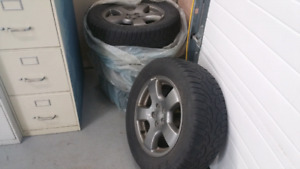 2004 Subaru Forester 225/60R16 winter tires on factory rims