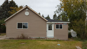13 acres with small house 30 min to Yorkton