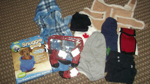 Selling an assortment of small dog clothes. Includes a snuggie,