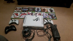 Xbox 360 bundle. Comes with remotes and 12 games