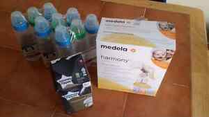 medela harmony hand pump and extra bottles