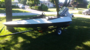 12ft speed boat. With 55 hp Johnson