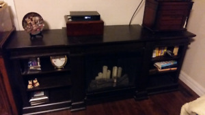 TV stand solid dark wood  very heavy  200.00