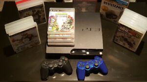 PlayStation 3 with two controllers and 25 games