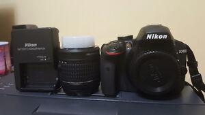 Nikon D3400 DSLR with 18-55mm lens, carrying bag, manual, etc.