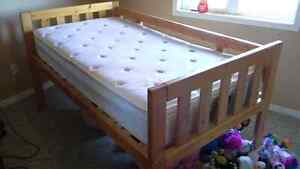 Raised single bed and mattress