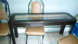 Narrow table and three chairs