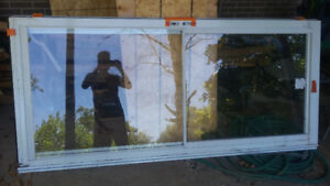"""Two brand new Anderson aluminum storm doors.6' 7 1/4"""" h x 2' 11"""""""