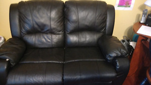 Black reclining leather couch and loveseat