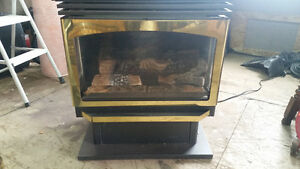 Gas propane fireplace with full chimney assembly