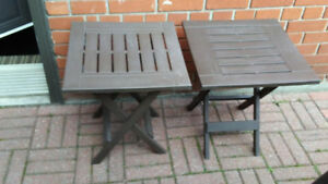 2 brown folding tables.