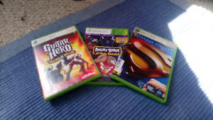 Xbox 360 games including superman angry birds and guitar hero