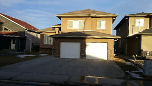 HUGE Bi-level 6 bedroom house with a DOUBLE ATTACHED GARAGE!