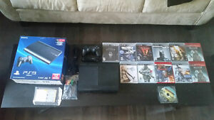 PS3 Slim with 12 games Windsor Region Ontario image 1