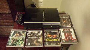 Excellent condition PS3 console, 2 controllers, 5 games