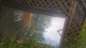 Large window panes trimmed in aluminum