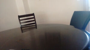 Dark cherry dining table sits 6
