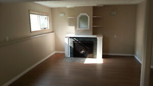 Bright 2 Bed Lower suite - East Cochrane - 1st month 1/2 off!