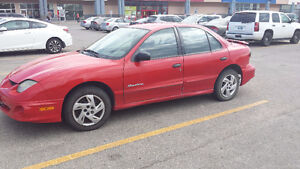 Pontiac Sunfire for 1900$ - Used and runs well.