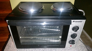 Convection oven with hot plates