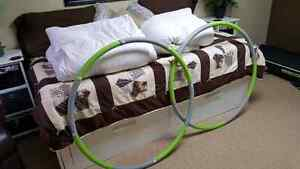Two Exercise Hula hoops and two Down Duvets
