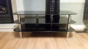 Brown leather Couch and black Glass tv stand