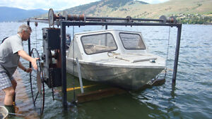 Heavy duty boat lift for smaller boat and sea doo on side as wel
