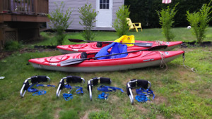 kayaks and rooftop Thule J shaped rooftop carriers for sale