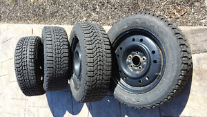 4 rims and winter tires.205/60/16 16 inch 5 bolt 114.3 firestone