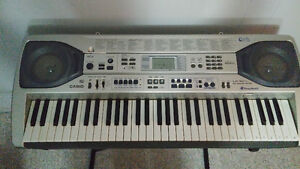 Piano Casio LK-92TV Electronic Keyboard