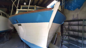 Two 27' Boats with boat trailers bargain priced.