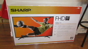 "Brand-new, SHARP, 40"" LED T.V. with FREE stand !!!"