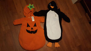 2 Halloween Costumes brand new, never used for newborn